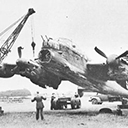 Recovery - Very bent, and with engine air intakes filled with earth, an early  Lanc, R5845 of 1660 Conversion Unit, Swinderby, is lifted ready for the recover trolley  by a crew of 58 MU.