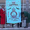 More than willing helpers Barbara Woods and granddaughter Erica help readying the 460 squadron banner.