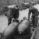 The Armourers loading 500lb bombs from the bomb dump. In the background 4000lb cookies lined up ready for loading.
