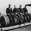 An indication of the size of the 4000lb (Cookie) Bomb shows Bill Gourlay (Nav) and 3 gunners from Vic Neale's crew. Photo taken of the Cookie to be loaded onto K2 in May 1944.