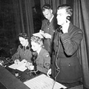 Flying control staff at work. L–R Betty Gardiner, Pat Hinton, Harry Oates (on phone) Fl/Lt Bernard Jones