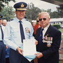 Laurie Woods, DFC (Qld/Pres), presents certificate to RAAF Amberley.