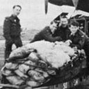 On the airfields of Nos. 1 and 3 Groups, the military men literally worked day and night to get the much needed food to Holland.